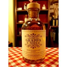 Liquore con grappa e miele 500 ml.
